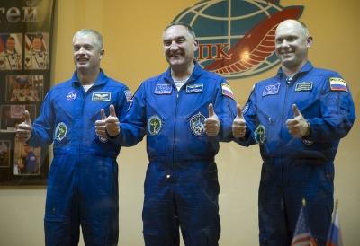 US astronaut Steven Swanson, left, Russian cosmonauts Alexander Skvortsov, center, and Oleg Artemyev.