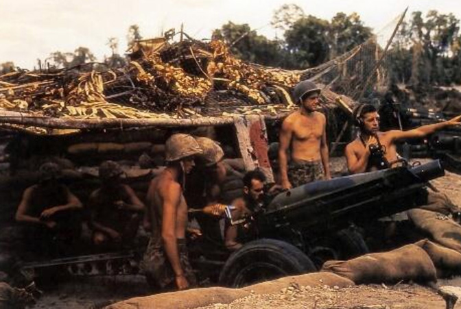 A 75mm pack howitzer of the 12th Marines, 3rd Marine Division, in a semi-fortified firing position on Bougainville late in 1943.