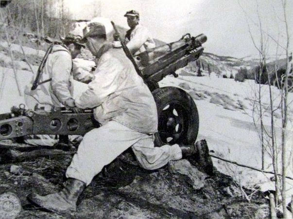 Soldiers of the 10th Mountain Division fire a 75 mm pack howitzer, Mt. Belvedere, February 1944.