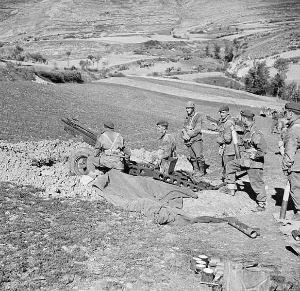 Gunners of the British 1st Air Landing Light Artillery Regiment, serving with 5th Division, in action with a 75mm howitzer during the advance on Isernia, Italy.