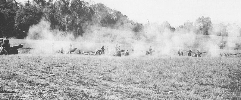 75 mm pack howitzers of the 1st Battalion, 11th U.S. Marine Regiment fire in support of the U.S. Marine and Army operation against Japanese forces around Koli Point on Guadalcanal in November, 1942.