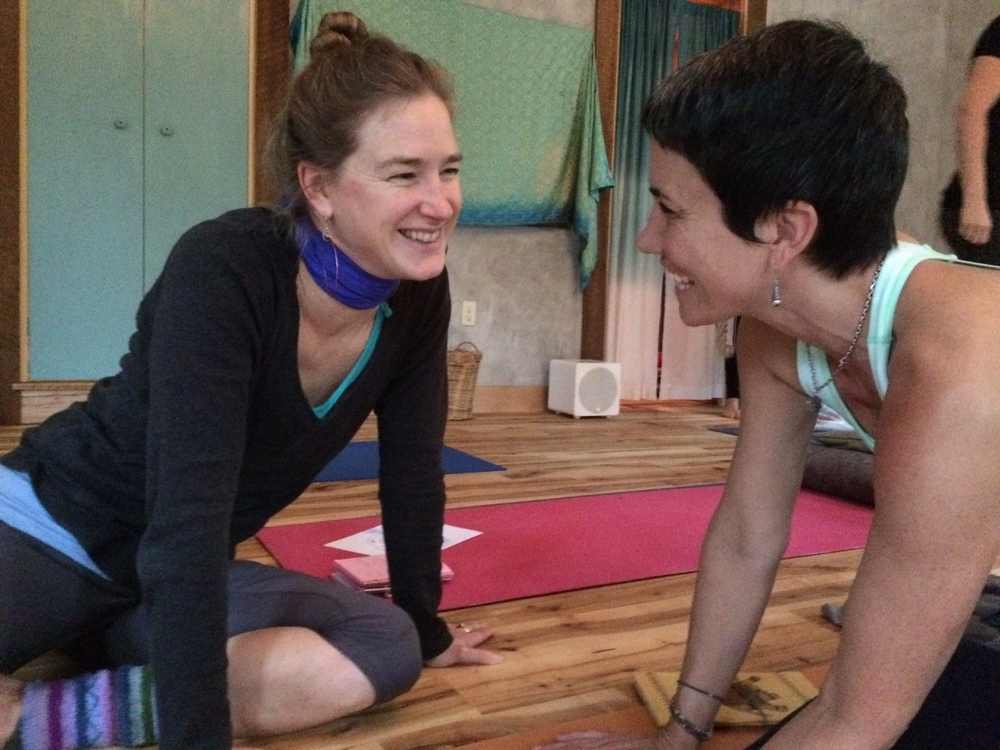 Two brilliant graduates of the 2014-2015 Yoga Teacher Training, sharing a heart connection between sessions.  Teacher trainees weave a web of lifelong friendships at Deva Daaru YogaFarm.
