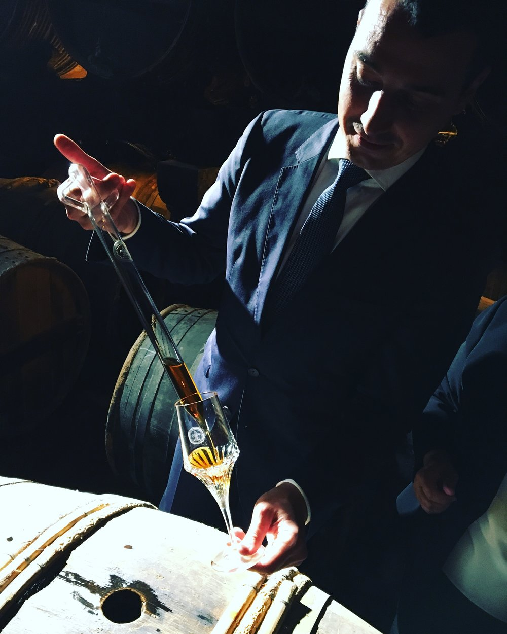 Baptiste pulls 100-year-old Louis XIII from the barrel.