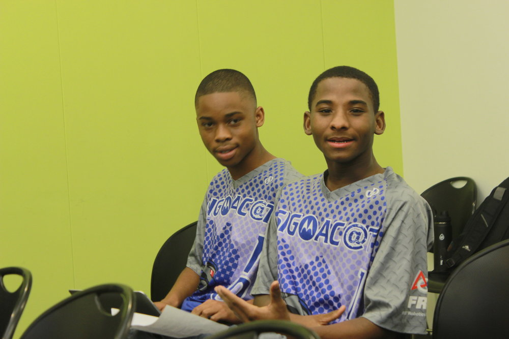 Two SigmaC@T members (Jordan Johnson, Pharaoh Campbell) sitting as they wait for the FRC Steamworks kickoff video to be released.