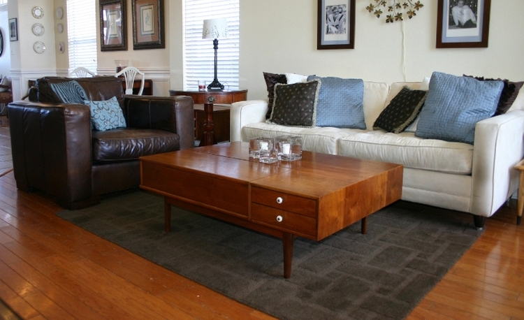 Proper sizing for a living room rug...before and after ...