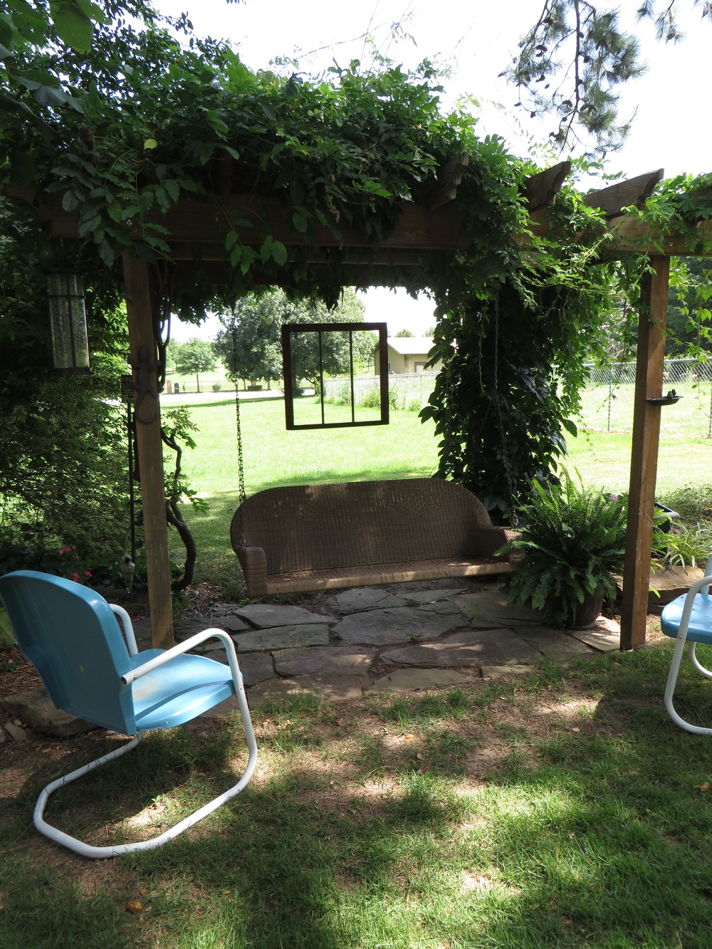 Backyard swing pergola