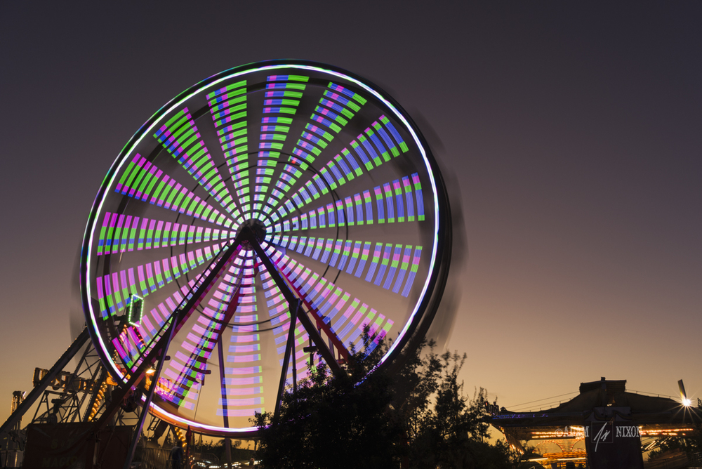 Spinning ferris wheel at twilight