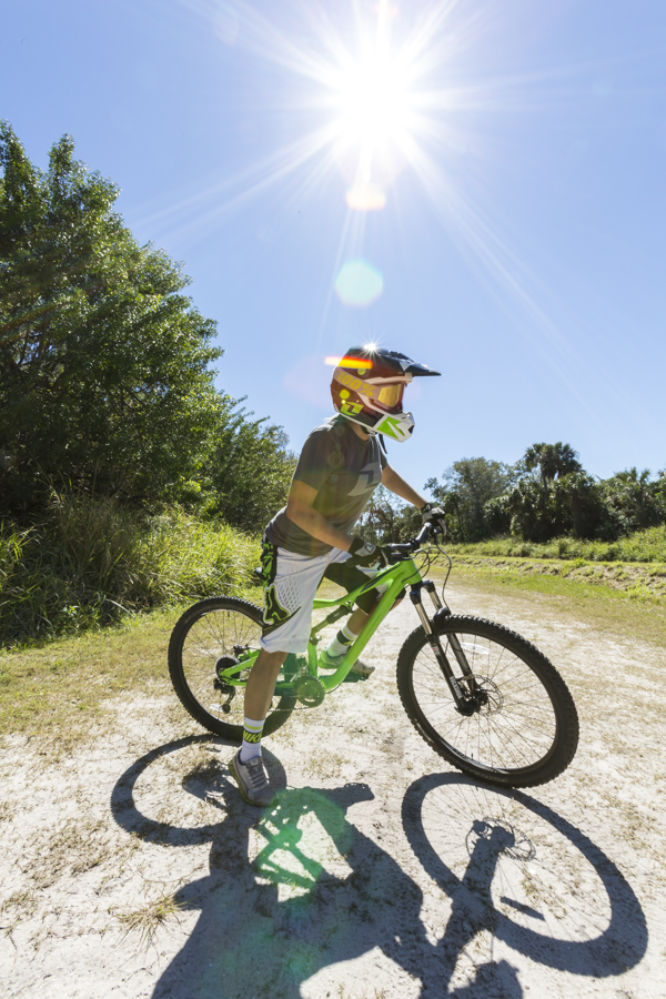 Portrait of a female mountain biker and sun burst