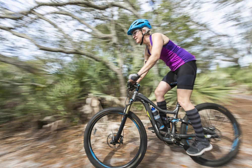 Female mountain biker riding the trails