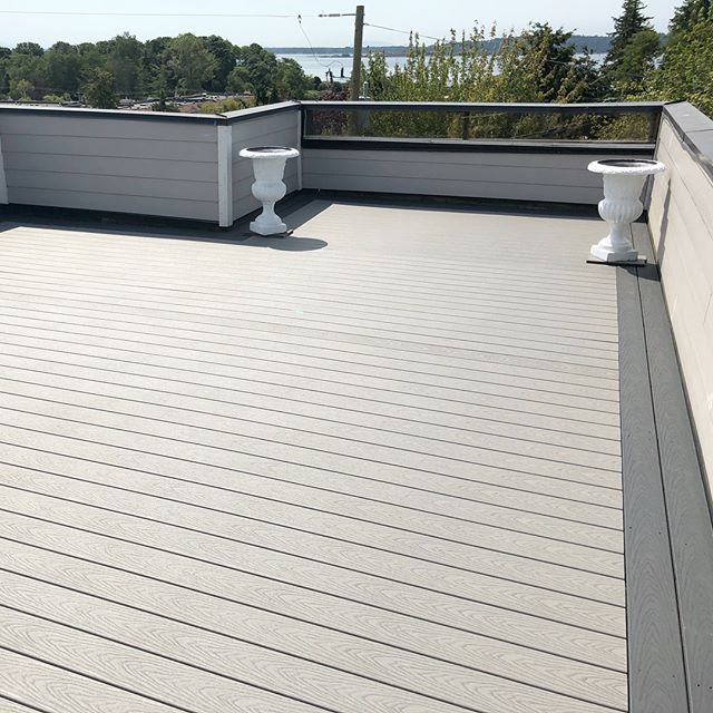 Rooftop deck install in White Rock. Swipe to see the old surface. Slight improvement! #trex