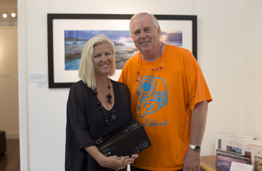 Pam accepting prizes from Ken at his Gallery on the Central Coast