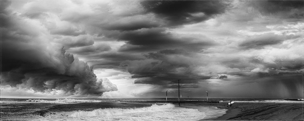 Lone Surfer on Mona Vale Beach in Black and White