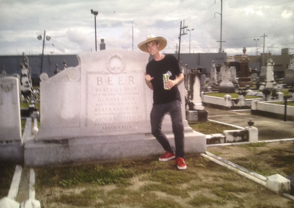 Nick Hatt at beer grave with 4 Loko.  New Orleans, 2013.   From a series of photos made during multiple extensive tours of the Bible Belt and the Mississippi Delta in the Southern United States.  The images reveal a stark glimpse into life below the Mason-Dixon line in all it's glory.  The entire project was shot on the road in a Keroucian frenzy as seen through the eyes of a rolling bandwagon of skateboarders.