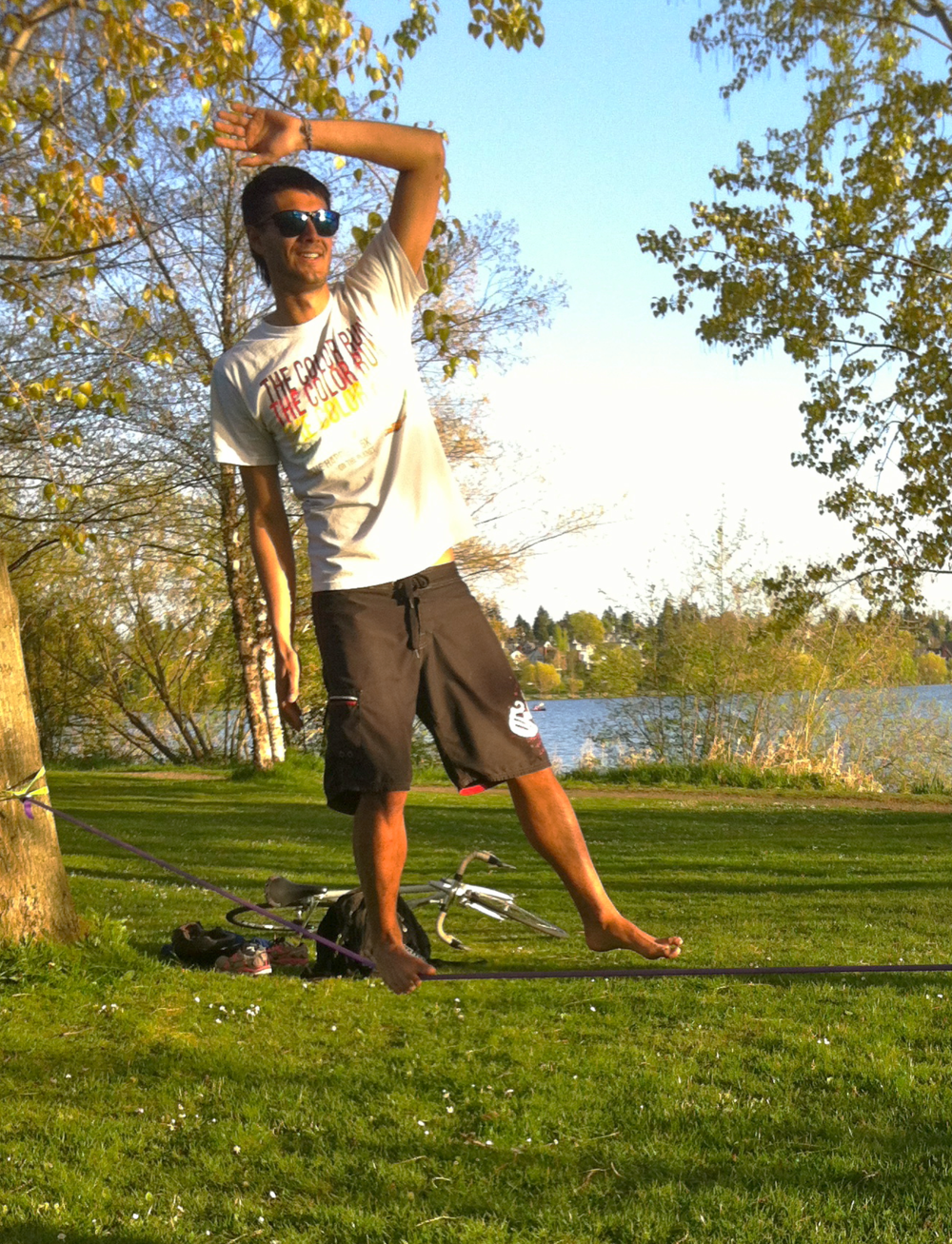 Sustainability is not a balancing act between trade-offs – it's about driving innovation.  Walking a Slack line at Green Lake, Seattle.