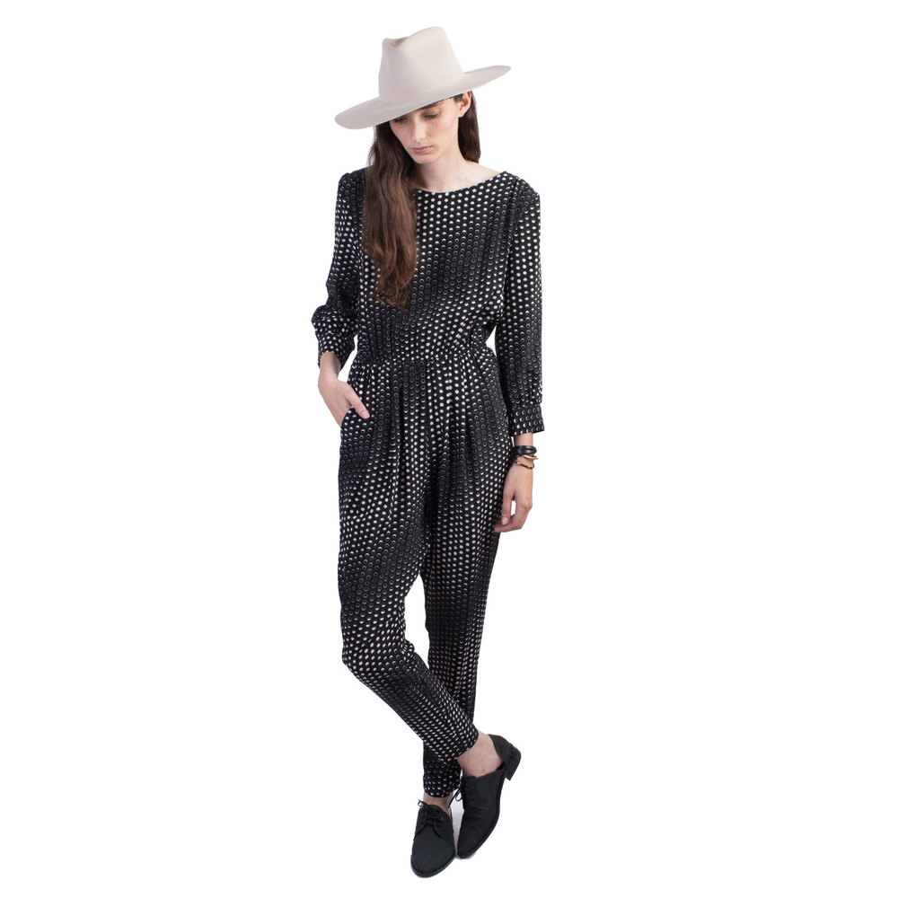 The Podolls  Moon Phases Jumpsuit  pairs nicely with a hat from Ryan Roche