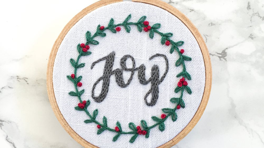 Joy Hoop Pattern - I am so excited for you to be stitching this hoop! This pattern uses four stitches, and you will find step by step instructions for them here, and in the downloadable PDF. The stitches you'll be using are: stem stitch, lazy daisy, brick stitch (made by using a back stitch), and french knot.