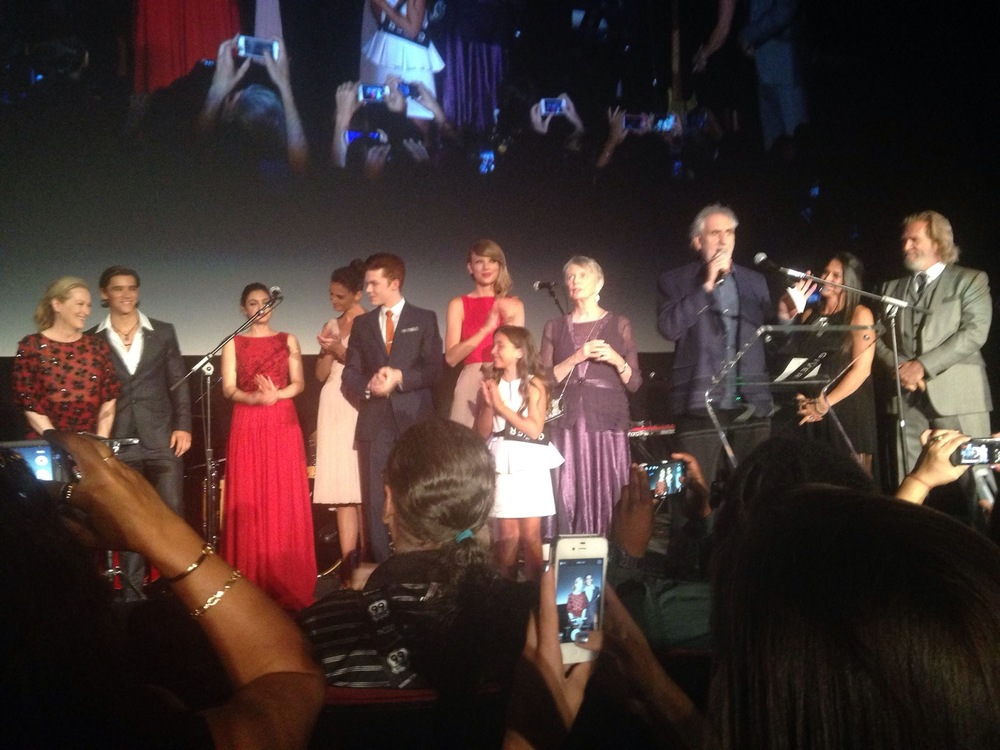 Photo credit: Colleen Khachatourians. L to R: Meryl Streep (Chief Elder), Brenton Thwaites (Jonah), Odeya Rush (Fiona), Katie Holmes (Mother), Cameron Monaghan (Asher), Taylor Swift (Rosemary), Emma Tremblay (Lilly), author Lois Lowry, director Phillip Noyce, producer Nikki Silver (?), producer Jeff Bridges
