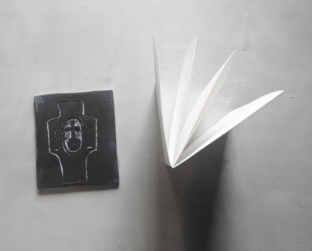 a Lino stamp and chapbook ready for a tutorial