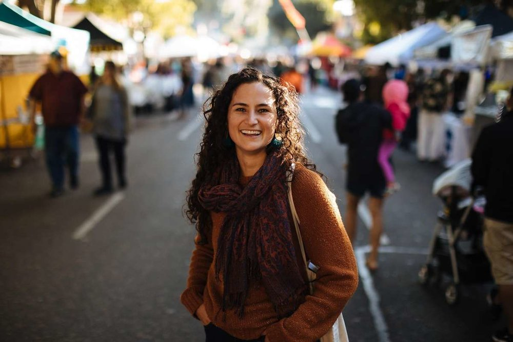 "Photo credit: Mason Trinca for the  San Francisco Chronicle . Kendra Aronson, author of the "" The San Luis Obispo Farmers' Market Cookbook: Simple Seasonal Recipes & Short Stories from the Central Coast of California ,"" photographed at the Farmers Market in San Luis Obispo."