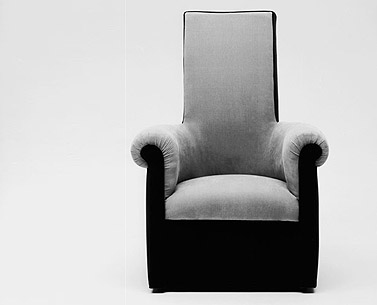 CH71: 1923-27  |                                      Pierre Chareau                                      Armchair with hardwood frame covered with expanded foam. Not removable upholstery velvet.