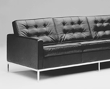 FL23: 1954  |                                      Florence Knoll Schust                                       Three-seat sofa with wooden structure lined with foam and chrome plated steel tube base. Different density foam cushions covered with not removable leather or fabric squares.