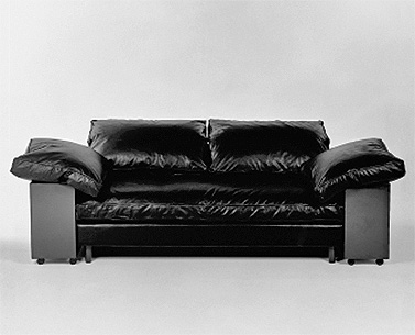 GR23: 1924  |                                      Eileen Gray                                       Three seat sofa with hardwood frame lined with expanded foam and covered with polyester. Down filled seating and cushions. Side cases in MDF lacquered in black polished to a high gloss finish. Not removable upholtery in leather. Available also with removable covering in fabric.