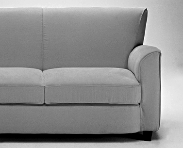 LE82: 1929-30  |                                      Jules Leleu                                      Two-seat sofa with hardwood frame and metal reiforced back lined with expanded foam and covered in cotton fabric. Cushions in foam covered in cotton fabric. Upholstery options are leather or removable fabric slip cover. Feet in Italian nut with beeswax finish.