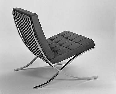 MI34:  1929  |                                      Ludwig Mies Van Der Rohe                                       Chair with frame in chrome plated flat bar steel. Suspension in   hide straps. Seat and backrest in expanded foam lined with polyester fiber.