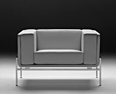 SA21:  1950 ca.  |                                      Eero Saarinen                                        Armchair with structure in chromed square steel tube. Wooden frame lined with shaped expanded foam. Cushions in expanded foam at different densities; non removable covering in leather or fabric.