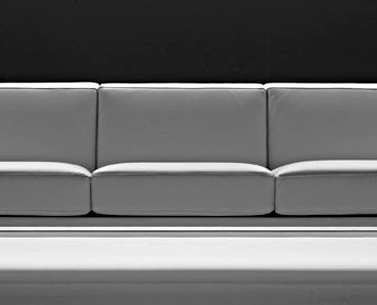 SA23:  1950 ca.  |                                      Eero Saarinen                                       Three seat sofa with structure in chrome-plated square shaped steel tube. Wooden frame covered with shaped expanded foam. Cushions in expanded foam at different densities; not removable covering in leather.