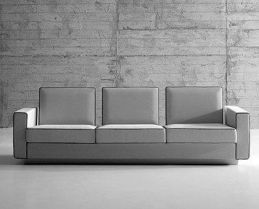 SA33: 1959  |                                      Eero Saarinen                     Three seat sofa with wooden structure, lined with foam. Different density foam cushions. Not removable upholstery in leather or fabric.