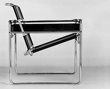 BR35:  1925  |                                      Marcel Breuer                                        Lounge chair with frame in chrome plated steel tube. Seat, back and arms in colored saddle leather. Flat welded endcaps.