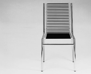 HE24:  1928-30  |                                      René Herbst                                        Chair with chrome-plated tubular steel frame. Seat, back and arms in black elastic cords. Also available with lacquered frame.