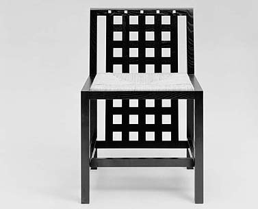 MA44: 1918  |                                      Charles Rennie Mackintosh                                     Side chair with frame in black lacquered ash with mother of pearl inserts. Seat in woven straw or upholstered in expanded foam covered in velvet, fabric or leather.