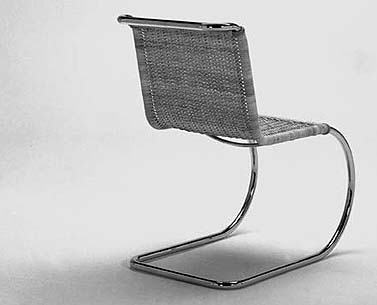 MI04: 1927  |                                      Ludwig Mies Van Der Rohe                                       Side with tubular steel frame polished chrome. Seat and back in hand woven natural cane. Available also in pith.