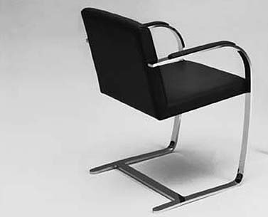 MI45:  1930  |                                      Ludwig Mies Van Der Rohe                                     Armchair with chrome plated flat bar steel frame. Hardwood seat covered in expanded foam.  The armchair was designed for the bedroom of  Tugendhat house in Brno in 1930. It was initially produced by Berliner Metallgewerbe Joseph Müller, and from 1931 by Bamberg Metalwerkstätten.
