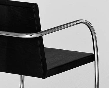 MI55:   1930  |                                      Ludwig Mies Van Der Rohe                                           Armchair with chrome plated tubular steel frame. Hardwood seat covered in expanded foam.