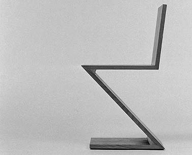 "RI14:  1934  |                                      Gerrit Thomas Rietveld                                       Chair with solid natural ash frame.  The ""Zigzag"" chair was designed by Rietveld in 1934 and was produced for some years by Metz & Company, Amsterdam."