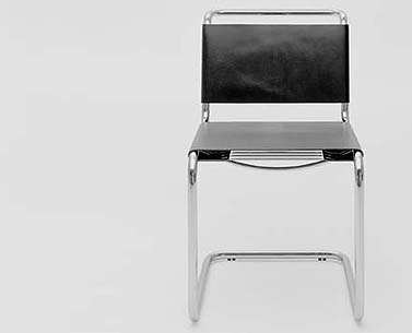 ST44:  1926-29  |                                      Mart Stam      Side chair with chrome-plated tubular steel frame. Seat, back and arms in hide in a variety of colors.