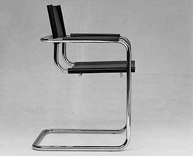 ST65:  1926-29  |                                      Mart Stam                                        Armchair with chrome plated tubular steel frame. Seat, back and arms in hide in a variety of colors.