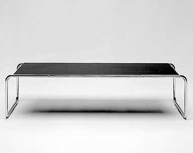 BR09-2:  1926  |                                      Marcel Breuer                                       Coffee table in chrome-plated tubular steel with black or white laminate top.