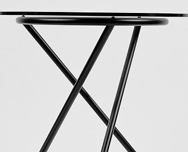"CH69:  1932  |                                      Pierre Chareau                                      Table with structure in lacquered steel tube glass top thickness 12 mm.   This small table was used in the waiting-room of Dr. Dulsace's consulting room in his ""home-cum-surgery"" Maison de Verre."