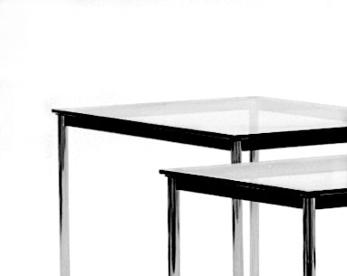 "CO39:  1927-28  |                                        Le Corbusier                                       Rectangular table. Frame in lacquered steel. Legs in chrome  plated tubular steel. Available either  cm 37 (14.5"") or cm 72 (28.3"") high."
