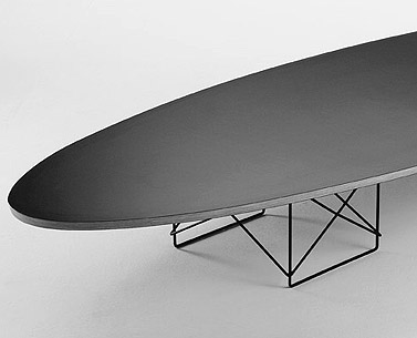 EA39:  1948-50  |                                      Charles Eames                                       Table with elliptical top in birch plywood covered with high pressure laminate. Black lacquered steel wire base.   An icon of the fifties'design, this table was designed by Eames with easily available industrial materials, familiar to the public to whom it was directed.