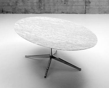 FL69-9: 1961  |                                      Florence Knoll Schust                                        Table with four-star base in chromed steel shaped and tapered. Adjustable foot. Oval top available in marble, lacquered MDF, laminate with visible birch plywood border or wooden veneered.