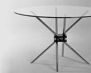 MZ59:  1928  |                                      Takehiko Mizutani                                       Table with legs in chrome   tubular steel. Black lacquered cast aluminium joint. Glass top 12mm.  Mizutani enrolled in the Bauhaus in 1927 and was one of the very few Japanese students who attended the school. The table had never been produced although the design, as a photo of models and drawings, was presented in various monographic publications about Bauhaus furniture.