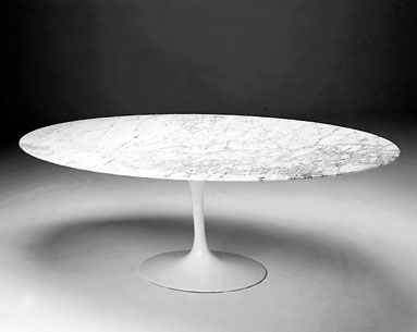 SA69-9:  1956  |                                      Eero Saarinen                                      Table with base in black or white lacquered cast aluminum. Oval top cm. 244x137 in Marble and cm. 240x120 in wood.