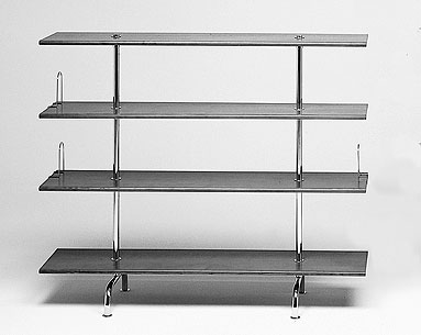 BR10-4:  1930-31  |                                      Marcel Breuer                                      Bookcase with four shelves in a variety of finishes: cherrywood/ashwood veneer, black/white laminate. Frame in chrome- plated tubular steel.