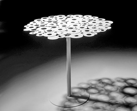 CENTRINO SMALL TABLE:  2009                                          Massimo Imparato                  Steel table, with top assembled by electro-galvanized welding rings and steel base. Available round and square in several heights and dimensions, lacquered in a wide range of colours.