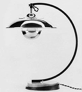 FO58:  1923  |                                      Mariano Fortuny                 Table lamp with base in solid stained oak and black lacquered steel; shade in chrome-plated aluminium. Max recommended 75w.